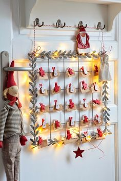 Advent calendar. All you need is a metal grate, some garland around the edge, some clothes pins painted and embellished and some tiny envelopes.