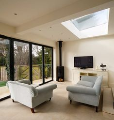 Surrey-based homeowners specified our market-leading SkyView rooflight to create a spectacular feature for their single storey extended living space. Bungalow Extensions, Garden Room Extensions, House Extensions, Kitchen Extensions, Open Plan Kitchen Dining Living, Open Plan Kitchen Diner, Open Plan Living, Open Plan House, House Extension Plans