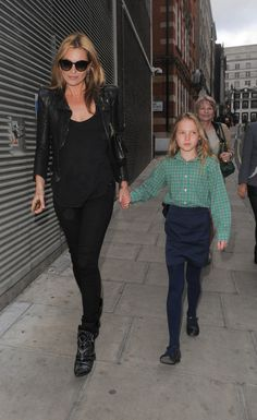 Kate Moss in all black everything basics with a Balmain leather jacket and western Isabel Marant ankle boots