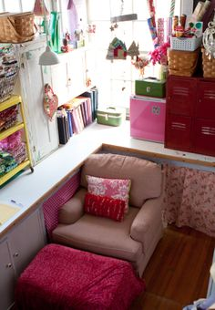 If I had the room for my own craft room, this pink, vintage wonderland would definitely be it...only with more counter space involved. I'm imagining there's a huge crafting/sewing/cutting table somewhere out of the frame. =)