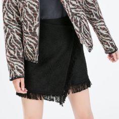 ZARA jacquard wrap skirt Zara asymmetric jacquard wrap skirt with fringe // button and snap closure // true to size // never worn by me, rePosh Zara Skirts Mini