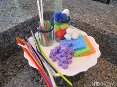 help your child strengthen fine motor skills, check out these simple toys you can make from items already in your kitchen!