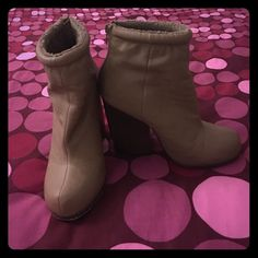 Forever 21 Ankle Booties Forever 21 Taupe Ankle Booties. These are size 7 and fit true to size. They have a faux fur lining, very soft. Zip up closure on the back of the ankle. Heel is approximately 3 inches. Very cute and still in good condition. I didn't wear very often. They are a few small marks that are visible. If you want additional pictures just ask Forever 21 Shoes Ankle Boots & Booties