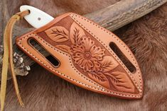 The Cowboy and its tooled Pancake sheath by Dave Ferry at www.horsewrightclothing.com