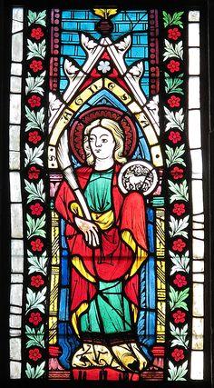 Saint Agnes. 1340-1350 Austrian, Pot-metal glass, colorless glass, and vitreous paint, Cloisters Collection, dimensions 35 x 13 in. (88.9 x 33 cm), Metropolitan Museum of Art.