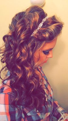 Homecoming hair.  Long curls all down one side perfect for strapless dress