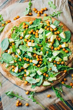 This healthy vegan pizza is a nutritious AND delicious - with turmeric chickpeas, cashew cheese, arugula and spinach, and chopped avocado.