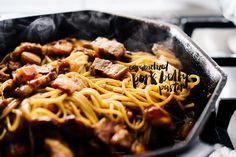 Vietnamese Caramelized Pork Belly Pasta Recipe with sugar, pork belly, water, fish sauce, shallots, onions, black pepper, spaghetti, cook and drain, sliced green onions