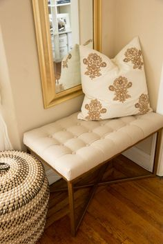Target tufted bench, embellished pillow, and a gold framed long mirror in a living room nook - love!