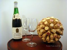She glues the corks to a styrofoam ball A few steps later? This tabletop idea is gorgeous!