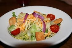 Tried this!  This is part of a regular meal at our house.  Love the dressing and crutons!!! Outback House Salad