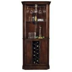 690000 Howard Miller Cherry traditional corner wine cabinet PIEDMONT This elegant traditionally styled wine cabinet combines plentiful storage with a convenient space-saving corner design.The lower cabinet features a metal wine rack with a capacity of 13 wine bottles, and two fixed shelves, which offer storage for spirits, mixers, and bartender's guides.