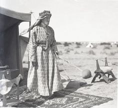 Lawrence photographed by Chase on a desert morning in front of his tent at Guweira, March 1918.