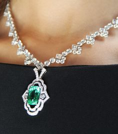 Louis Vuitton 10.14 carat Paraiba tourmaline from Mozambique and diamond necklace from the Louis Vuitton Conquêtes collection presented July 2017.