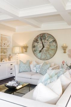 coral, beachy pillows and a statement piece of art