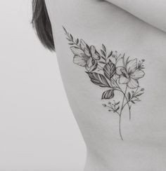 Delicate black and grey ink floral tattoo on rib cage by Tritoan Ly #tattoosforwomenunderboob