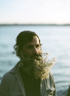 David Winward allowing his floral wizard wife, Sarah, to play with his beard
