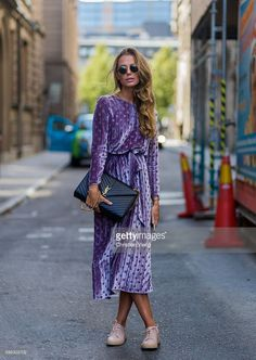 A guest wearing a purple dress and Yves Sain Laurent bag outside Nhorm during the third day of the Stockholm Fashion Week Spring/Summer 2017 on August 31, 2016 in Stockholm, Sweden. (Photo by Christian Vierig/Getty Images)