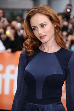 The cool skinned Alexis Bledel rocks a navy blue dress to the premiere of