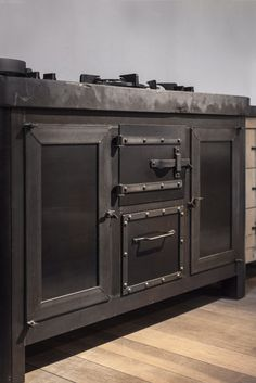 Cooking furniture iron and bluestone by Dirk Cousaert Design