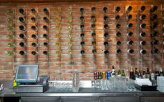 Bodega Wine Bar....can be done at home...great display with bottles and used brick background