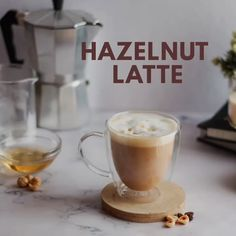 How to make Hazelnut Latte at Home Here's a quick recipe of Hazelnut Latte at home. Ingredients: Hazelnut Syrup, Espresso / Strong Coffee, Steamed Milk,Foam and toasted hazelnut. Coffee Tasting, Coffee Drinkers, How To Make Coffee, How To Make Cappuccino, How To Make A Latte, Cappuccino Coffee, Iced Coffee, Nespresso Recipes, Comida Keto