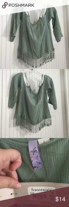 New Listing Francesca's Alya cold shoulder top Beautiful sage green Alya top with fringe bottom from Francesca's. Adjustable straps. 100 % crinkle rayon. 3/4 length bell sleeves.. From smoke free home. Francesca's Collections Tops Blouses