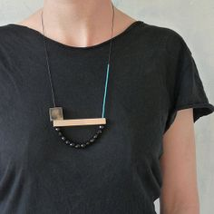 Wooden beaded necklace in yellow, turquoise, black and pink