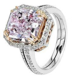 Light pink diamond engagement ring.