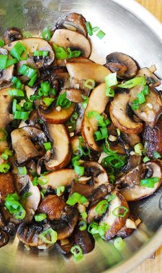 Mushrooms sauteed with garlic in olive oil and topped with green onions (or chives): juicy and delicious meal, with a meaty flavor and texture! Great vegetarian dish or side dish for grilled steak.