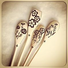 Set of four floral woodburned spoons