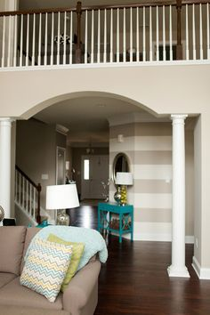"Color Palette with grey brown couch Paint Color | Sherwin Williams ""Amazing Gray"" stripe wall"