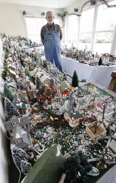 Dan Gustafson displays a miniature Christmas village in his home near Wakefield, Nebraska.