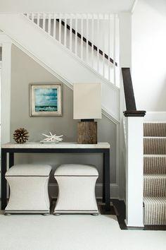 Gorgeous Stair carpet!  Coastal colors, wall color,  ottomans.