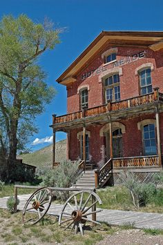 A pair of busted wagon wheels lean against the hitching rail in front of the Hotel Meade in Bannack, Montana.  Bannack was a boom town during the gold rush of the 1860s, and served as the first territorial capital.