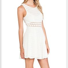 Lace Free People dress Perfect sundress for any occasion, dress it up or down, pair it with heels or flats, and with jewelry or a floppy hat! cream and lace Free People sundress, skin shows through in the middle, zippers up the back. Free People Dresses Mini