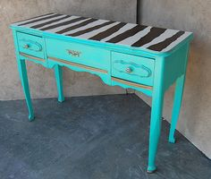 Zebra and turquoise painted table.