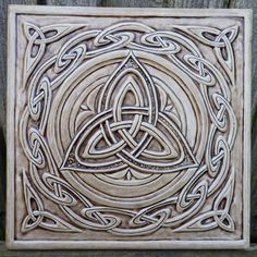 "Central triskelion surrounded by a ""Celtic wave"" border.  OK. Not zelij, but it's always nice to contrast and compare (and ask, how would a zelij artist render a triskelion?)   Celtic ceramic tile"