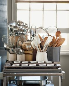 Whether you use one crock or several, it's wise to have essential tools in arm's reach when you're at the stove. A cart provides storage where you need it. Martha keeps ladles, whisks, pastry brushes, wooden spoons, and flexible spatulas in separate containers on her cart.