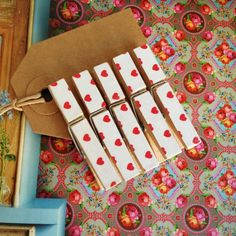 5 small wooden clothes pegs, white with red hearts. £2.50, via Etsy.