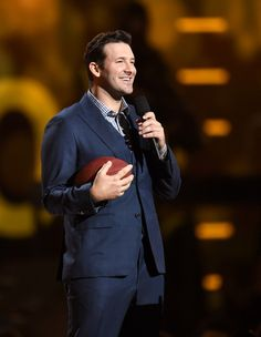 Tony Romo Photos Photos - NFL player Tony Romo speaks onstage during the 50th Academy Of Country Music Awards at AT&T Stadium on April 19, 2015 in Arlington, Texas. - 50th Academy Of Country Music Awards - Show