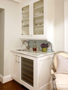 "Even the tiniest wet bar will be a boon for entertaining if you choose the right spot for it. ""It makes sense to fit the bar near the traffic pattern of the party,"" says Gretchen Brown, who created this diminutive 3½-foot-wide by 2-foot-deep drinks station using custom cabinetry painted in Benjamin Moore's Snowfall White."