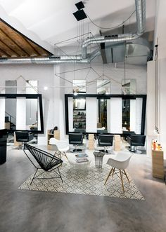 A volumetric WIREFLOW design lights up the lounge at Noguera Hair & Art Salon in Barcelona. http://www.vibia.com/en/lamps/show/id/02994/hanging_lamps_wireflow_0299_design_by_arik_levy.html