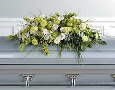 Send Green and White Casket Spray in Murrysville, PA from Berries and Birch Flowers, Gifts & Home Decor, the best florist in Murrysville. All flowers are hand delivered and same day delivery may be available. Flower Wreath Funeral, Dad Funeral Flowers, Flowers For Men, White Flowers, Beautiful Flowers, Funeral Caskets, Casket Flowers, Funeral Sprays, Casket Sprays