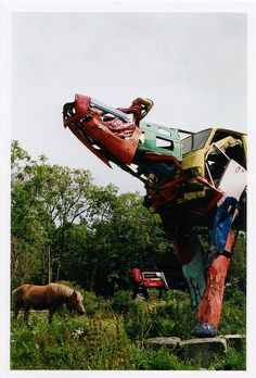 The Finnish sculptor Miina Äkkijyrkkä purchases dozens of used vehicles from dealers around Finland and uses them to create enormous cow sculptures! | Ripley's Believe It or Not!