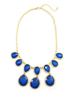 Make a statement with this stunning bib necklace featuring different-sized opalline teardrops in striking cobalt, framed by golden finery.Item Details: -Length: 18