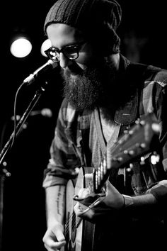 William Fitzsimmons. All day, every day. Seriously, his stuff is amazing- simple, acoustic, beautiful. The best driving-through-the-mountains/reflective-showering/looking-at-old-photographs music.