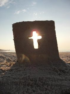 Cross Sandcastle at Sunrise,  Sand Sculptures by Mike Bradley