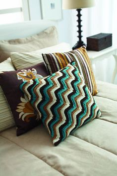Crochet Zig Zag Pillow. Although I would likely switch up the pattern a bit with a lazy chevron instead of the hard angles