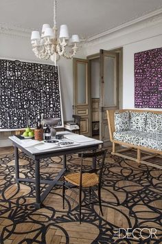 This highly-curated French duplex apartment is like an interactive art museum. A studio in one of two apartments that the artist and designer Christian Astuguevieille maintains in Bayonne, France. He designed the sofa and its fabric, available through Holly Hunt, as well as the table and chandelier, and he created both the pattern on the oak parquet floor and many of the room's artworks, using Chinese calligraphy ink.